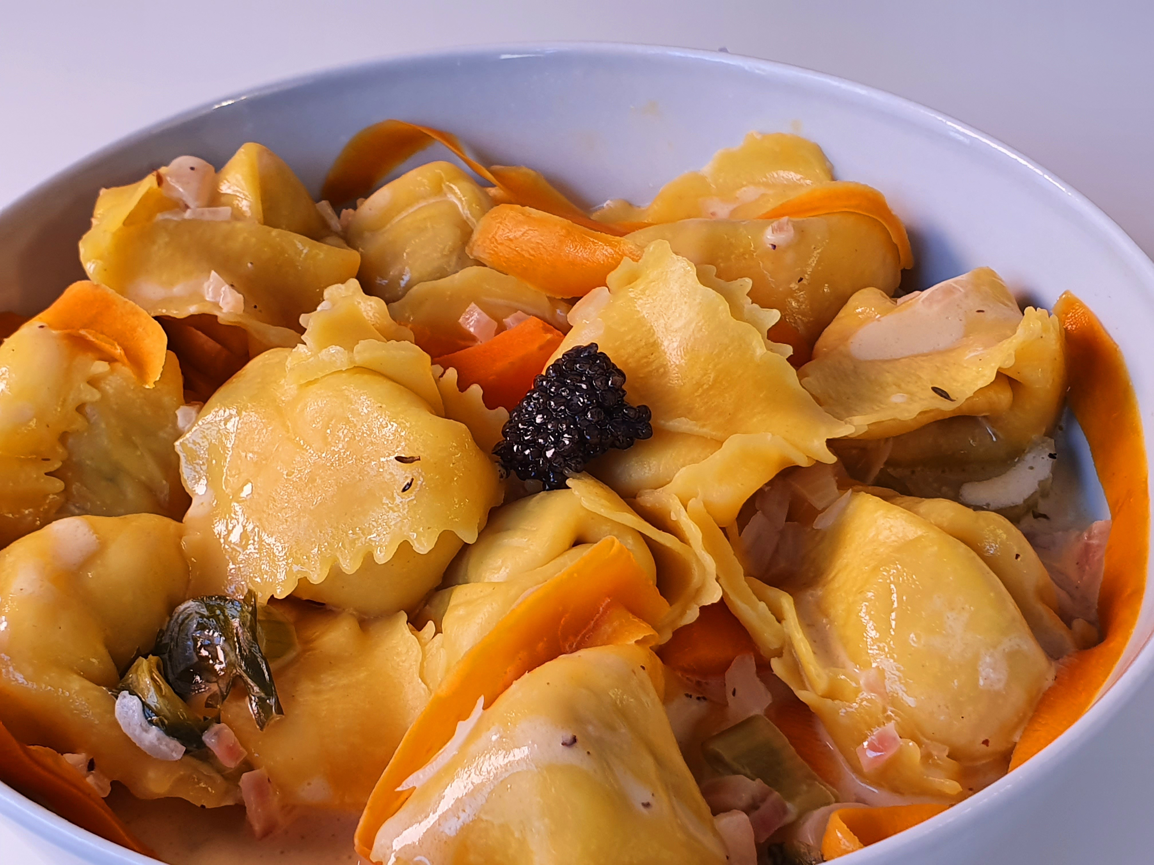 Ravioli stuffed with Sturgeon, Caviar and seafood topping