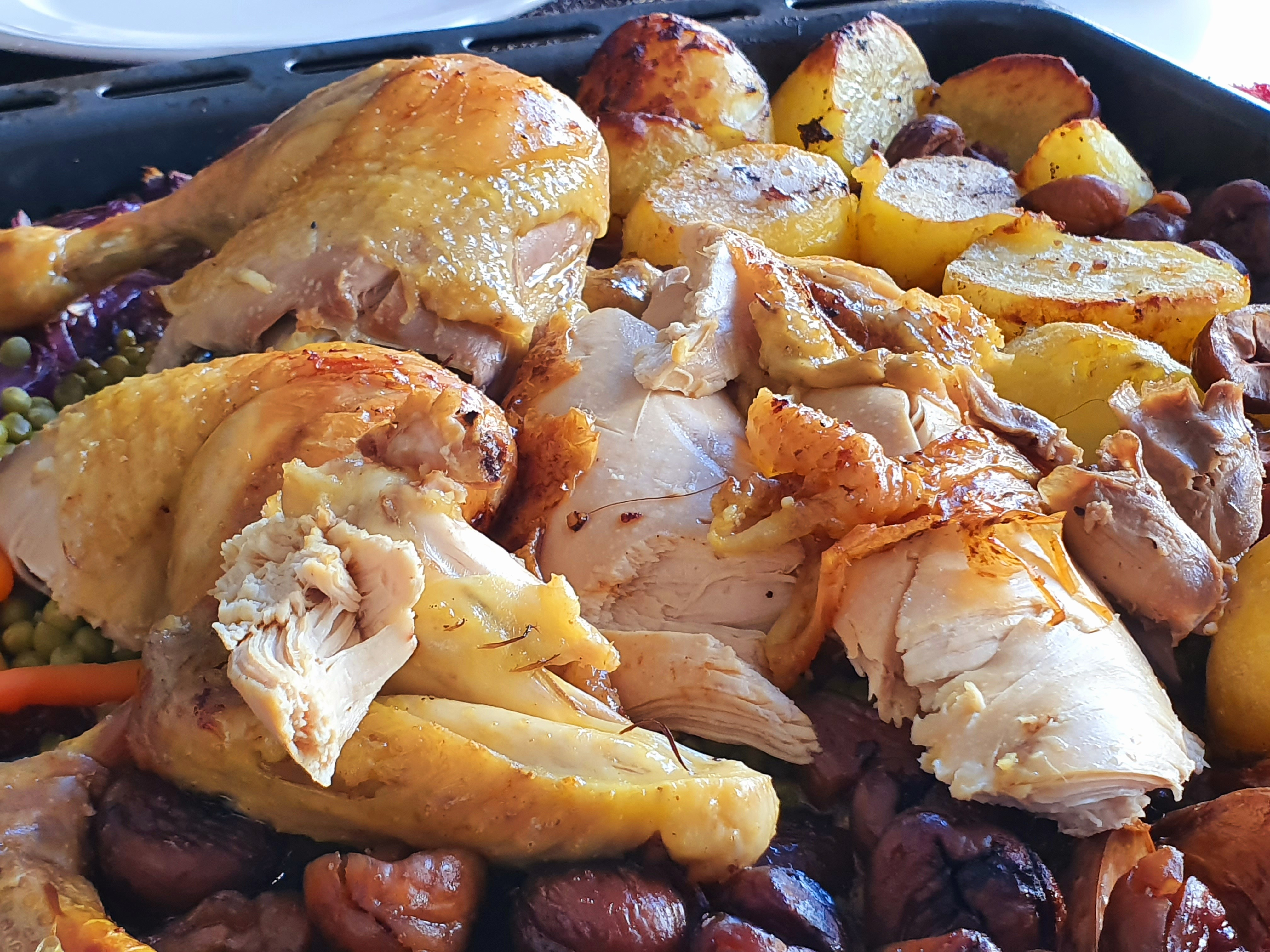 Roasted chicken with chestnuts, red onions and candied potatoes